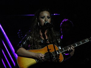 "Here We Go Again (Demi Lovato album) - Lovato performing ""Catch Me"" during A Special Night with Demi Lovato"