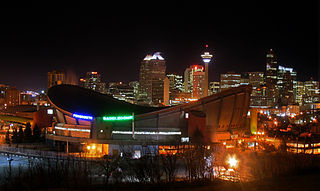 Saddledome and Calgary skyline at night