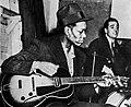Charlie Christian and Gene Krupa (1940-02-07 Metronome All-Stars session photo).jpg