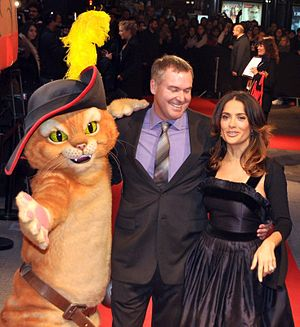 Chris Miller (animator) - Miller with Salma Hayek at a premiere of Puss in Boots in Paris