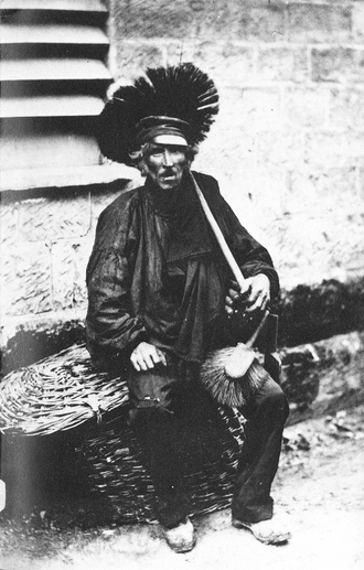 Chimney sweep - A chimney sweeper in 1850.