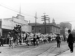 parade of a chinese dragon in seattle c 1909