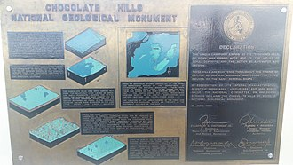 Chocolate Hills - Historical marker explaining the geologic evolution of the area.