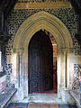 Church of the Holy Trinity - nave door exterior - East Grimstead, Wiltshire, England.jpg