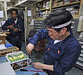 Civilian mariner Pete Jimenez prepares a static voltage regulator for installation in the engine room of the hospital ship USNS Mercy (T-AH 19) Aug. 28, 2012, while under way in the Pacific Ocean 120828-N-KW566-001.jpg