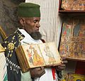 Cleric Displaying Manuscript Paintings at the Monastery of Na'akuto La'ab (3419120053).jpg