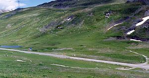 Little St Bernard Pass - View of the stone circle crossed diagonally by the road. Remains of World War II fortifications are also visible.