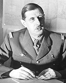 Commander of Free French Forces Charles de Gaulle seated (cropped).jpg