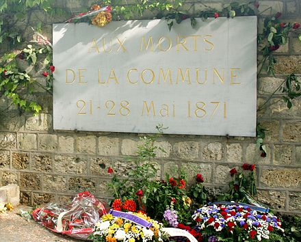 A plaque honours the dead of the Commune in Pere Lachaise Cemetery. Commune2011.jpg
