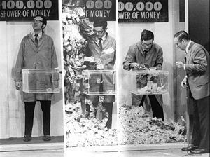 Concentration (game show) - The money shower segment in 1972.  Winning contestants entered this booth where bills valued from $5 to $100 were blown in the air.  The contestant had one minute to catch as many flying bills as possible and pass them through the small window as shown.  The contestant won the amount he or she was able to catch in the cash shower.