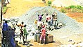 Construction site workers loading water, sand, ballast and cememt into a concrete mixer in Embu, Kenya 10 a.jpg