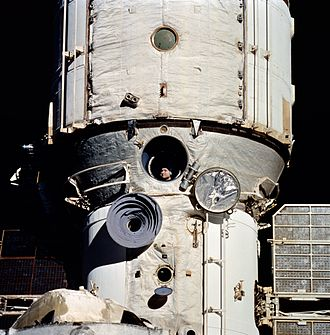 Valeri Polyakov - Polyakov observes rendezvous operations with the Space Shuttle ''Discovery'' on its STS-63 mission through a window on the Mir Core Module in February 1995.