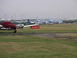 Coventry Airport - Two Thomsonfly Boeing 737s and a Farnair Switzerland ATR 72F on the ground