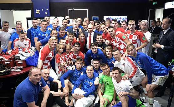 "The 2017-18 national squad, dubbed the ""Second Golden Generation"", posing with Vladimir Putin and Kolinda Grabar-Kitarovic after the 2018 World Cup Final against France. Croatia's post-match huddle after the 2018 FIFA World Cup Final.jpg"