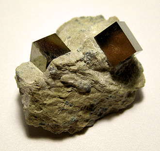Euhedral and anhedral - Euhedral pyrite crystals