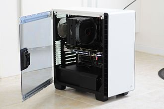 Homebuilt computer - Side view of a custom made PC. The motherboard and internal components are visible through the clear side panel.