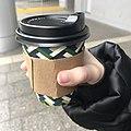 Cute little hand holding morning coffee.jpg