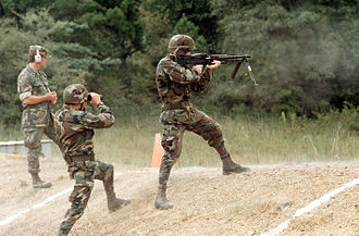 ERDL pattern - U.S. airmen in August 1988; the airman on the far left is wearing a BDU in the brown-dominant ERDL pattern.
