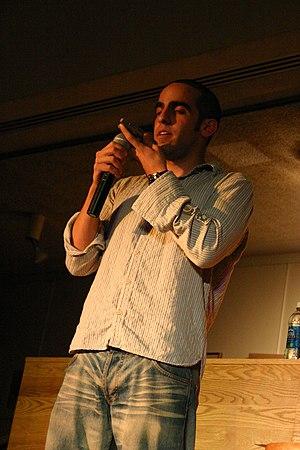 Dan Ahdoot - Dan Ahdoot performing on the Orange Carpet at Cornell College.