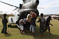 Defense.gov News Photo 101022-M-9842K-158 - Victims of Super Typhoon Megi unload humanitarian aid supplies from a U.S. Marine Corps CH-46 Sea Knight helicopter in Divilacan Isabela province.jpg