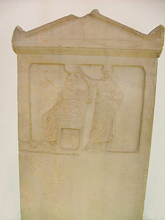 Athenian democracy - The relief representation depicts  the personified Demos being crowned by Democracy. About  336 BC. Ancient Agora Museum.