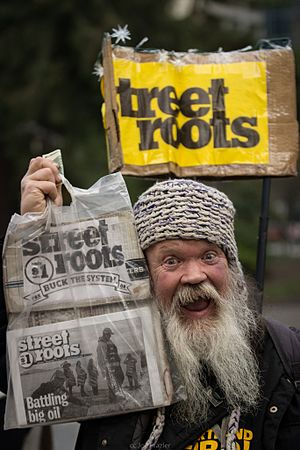 Street Roots - A Street Roots salesman with newspapers
