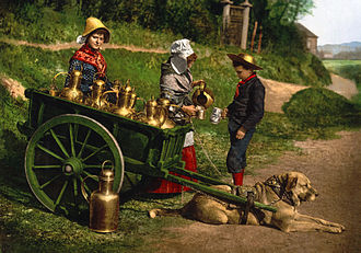 Dogcart (dog-drawn) - A photochrom from the late 19th century showing two peddlers selling milk from a dogcart near Brussels, Belgium