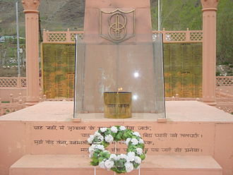 Dras War Memorial - Kargil War Memorial. On the background is the name of soldiers who died during the battle, and a memorial for them in the front.