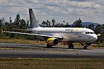 EC-LOB A320 Vueling SCQ.jpg