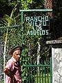 Elderly Man by Sign for Rancho Viejo Los Abuelos - El Valle de Anton - Cocle Province - Panama (11503365975).jpg