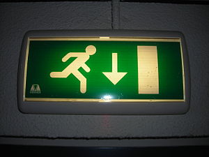 Emergency light with an emergency exit pictogram