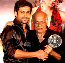 Emraan Hashmi is posing with Mahesh Bhatt