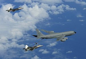 507th Air Refueling Wing - A 465th ARS KC-135R refuels an F-22A near Guam, 2010