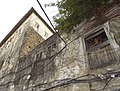 Facade with Man in Window - Stone Town - Zanzibar - Tanzania (8830674620).jpg