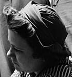Face detail, We Can Do It- Women riveters (1942) (cropped).jpg