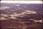 Area west of Fairbanks, looking SW, showing University of Alaska Fairbanks and Fairbanks airport and Tanana River. Image taken before 1975.