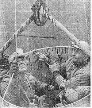 Bucket (machine part) - Three miners are extracted during the Farmington Mine disaster, in a bucket attached to a crane