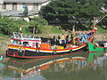 Fishing boat arrived in the morning (8217735878).jpg