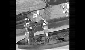 Forward looking infrared - FLIR imagery from a U.S. Navy helicopter: Alleged drug traffickers are being arrested by Colombian naval forces.