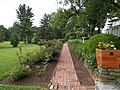 Flower lined walkway in back of Dwight Eisenhower's house.jpg