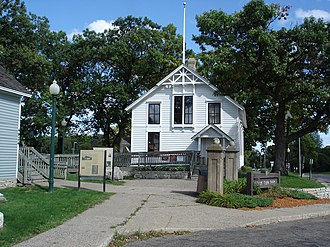 Edina Public Schools - The Old Cahill School and the Minnehaha Grange Hall (blue building to the left) located on the grounds of Frank Tupa park