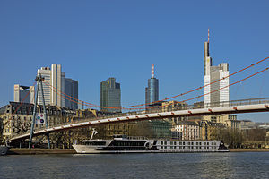 Frankfurt-Germany skyline with river Main bridge Holbeinsteg and ship excellence royal.jpg