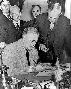 Franklin Roosevelt signing declaration of war against Germany