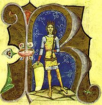 A young crowned man wearing a shield