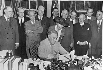 G.I. Bill - President Roosevelt signs the G.I. Bill into law on June 22, 1944