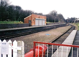 Belgrave and Birstall railway station - Overview of the station from the public entrance in 2001. Note the new station building and the old Belgrave and Birstall bridge in the background