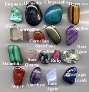 A selection of gemstone pebbles made by tumbling rough rock with abrasive grit, in a rotating drum. The biggest pebble here is 40 mm long (1.6 inches).