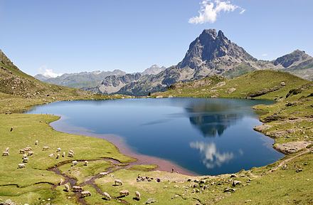 Lac Gentau reflecting the Pic du Midi d'Ossau (Pyrenees, France). Lacustrine environments only make up a small portion of the total depositional environments. Gentau Pic du Midi Ossau.jpg