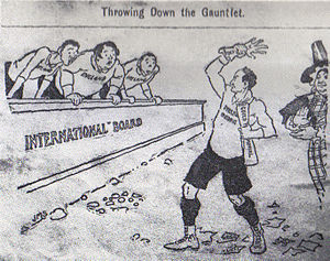 "Hand drawn cartoon, titled ""Throwing down the Gauntlet"". The cartoon depicts three caricatures representing the England, Scotland and Ireland Unions, looking aghast as a figure representing the Welsh Union throws a defiant Gauntlet to the ground. The Welsh Union is applauded by Dame Wales."
