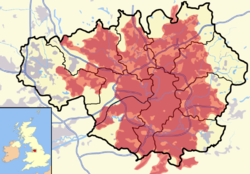 Mapa do condado de Grande Manchester, no Reino Unido. Em vermelho, a conurbação ocorrida a partir da cidade de Manchester.